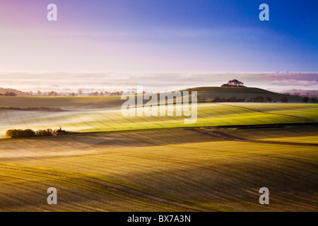 Misty autumn sunrise from Knapp Hill over the Vale of Pewsey in Wiltshire, England, UK - Stock Photo
