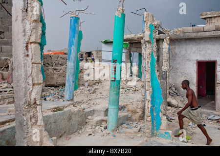A man walks through earthquake rubble on July 13, 2010 in the Fort National neighborhood in Port-au-Prince, Haiti. - Stock Photo