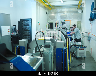 Scientists with particle accelerator - Stock Photo