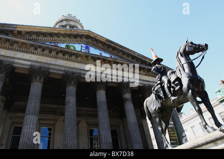 Duke of Wellington statue outside Gallery of Modern Art Glasgow with cone - Stock Photo