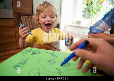 Boy painting on table - Stock Photo
