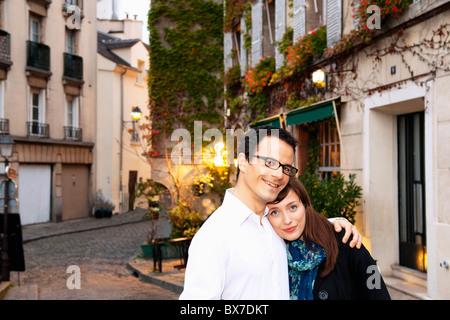 Couple embrace in monmartre Paris - Stock Photo