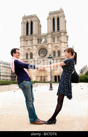 Couple in front of Notre Dame Paris - Stock Photo
