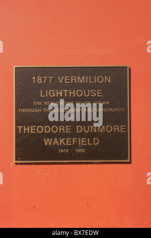 Memorial Sign for Vermilion Lighthouse on Lake Erie. Lighthouse at Vermilion Ohio USA. Vintage 1877. - Stock Photo