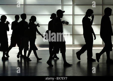 Silhouettes of young people, Berlin, Germany - Stock Photo