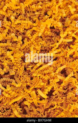 Detail of orange shredded packaging paper - background - Stock Photo