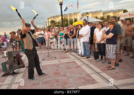 A street performer during the Sunset Celebration Mallory Square, Key West, Florida. - Stock Photo
