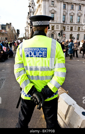 A Metropolitan police officer on duty at a demonstration in London - Stock Photo