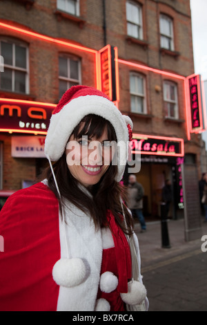 LONDON, ENGLAND - Santacon London 2010, female Santa in Brick Lane - Stock Photo