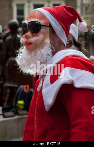 LONDON, ENGLAND - Santacon London 2010, Santa with mask - Stock Photo