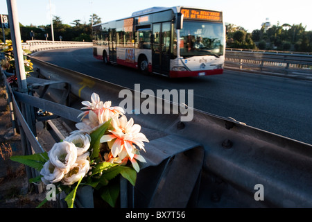 Flowers on roadside ground of  Rome Italy street, as memorial of fatal accident victim. - Stock Photo