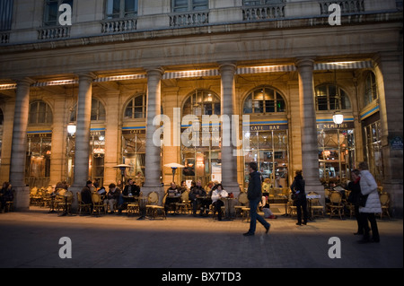 Paris, France, Outside, 'Le Nemours', people Sitting at Tables on sidewalk, Night Parisian street café scene - Stock Photo