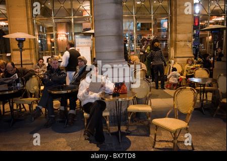 Paris, Cafe, France, People Sitting at Tables, Parisian Cafés, 'Le Nemours', Night, Woman Alone Outside, Parisian - Stock Photo