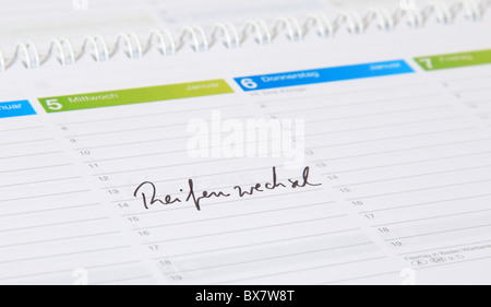 A calendar showing the german term Reifenwechsel. English translation; change of tyres. - Stock Photo