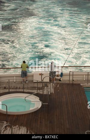 Passengers watching the wake from P & O ship 'Aurora' - Stock Photo