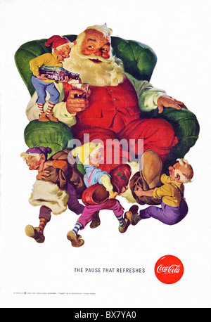 Classic Coca Cola advert in American magazine featuring colour illustration of Santa Father Christmas dated December - Stock Photo