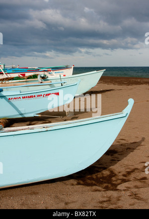 Bows of boats lined up along the shore. - Stock Photo