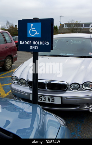 cars parked in disabled parking bays, uk - Stock Photo