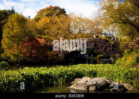 Autumn colors and Gapstow bridge in Central Park in New York City. - Stock Photo