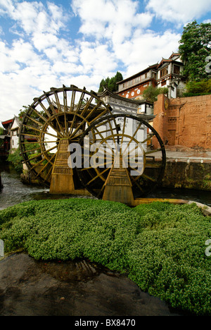 Water wheels in Lijiang's old town (Dayan), Yunnan, China - Stock Photo