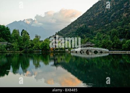 Sunrise at Black Dragon Pond, Lijiang, Yunnan, China - Stock Photo