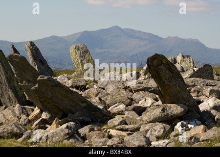Snowdon rises beyond the ancient stone ring cairn of Bryn Cader Faner