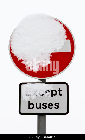Snow-covered 'No Entry' sign - Stock Photo