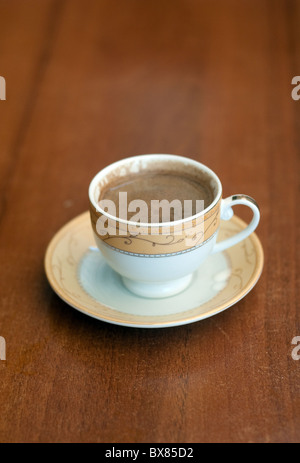 A cup of sweet Turkish coffee served at a cafe in the city of Diyarbakir, in the southeast Anatolia region of Turkey. - Stock Photo