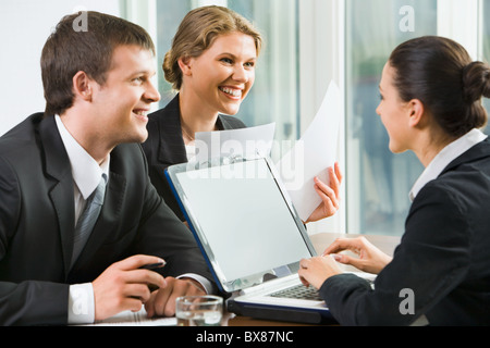 Business people tell conditions of the new agreement to their partner on job - Stock Photo