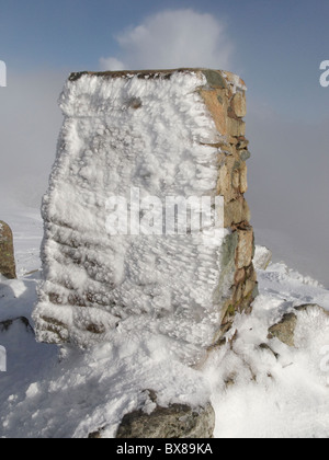 A rimed up Trigonometry point on the top of Moel Siabod - Stock Photo