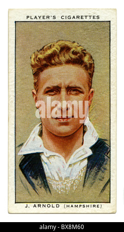 1934 cigarette card with portrait of cricket player of John Arnold of Hampshire and England - Stock Photo