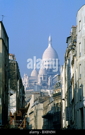 Sacre Coeur as seen from Chartres St, 18th Arrondissement, Paris, France. - Stock Photo