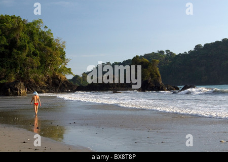 Woman walking on the beach at Manuel Antonio National Park in Puntarenas province, Costa Rica. - Stock Photo