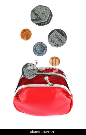 Sterling coins falling in to an open red coin money purse cut out isolated on a white background. England, UK, Britain - Stock Photo