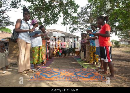 Women attend a community microfinance meeting in Kakata, Liberia, West Africa. - Stock Photo