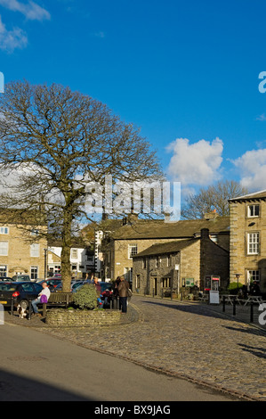 People tourists visitors in the village in autumn winter Grassington Upper Wharfedale North Yorkshire Dales England UK United Kingdom GB Great Britain