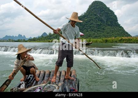 On the Yulong River on a bamboo raft, Yangshuo, Guangxi, China. - Stock Photo