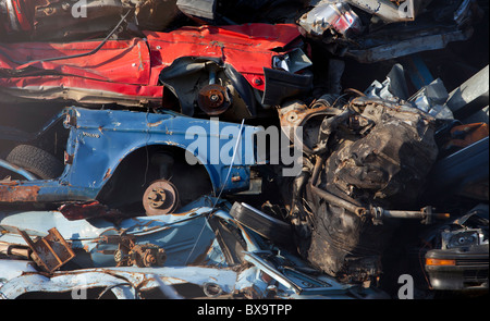 Close-up of pile of cars on scrapyard waiting for recycling - Stock Photo