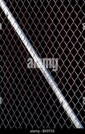 Metallic wire netting fence - Stock Photo