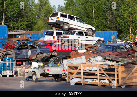 Pile of cars on scrapyard waiting for recycling - Stock Photo