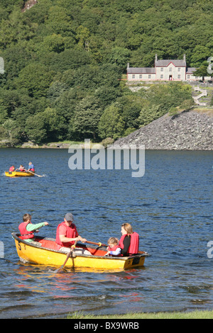 tourist in rowing boats on lake padarn in llanberis north wales - Stock Photo