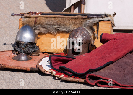 European medieval Slavic swords, helmets, shields and gambeson on display - Stock Photo