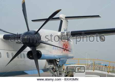 Amsterdam Schiphol Airport. The Netherlands. Engine of a Flybe dash-8 aircraft. - Stock Photo