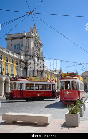 Portugal, Lisbon, the Arco de Triunfo in the Praca do Comercio (Terreiro do Paco) with tourist excursion trams - Stock Photo