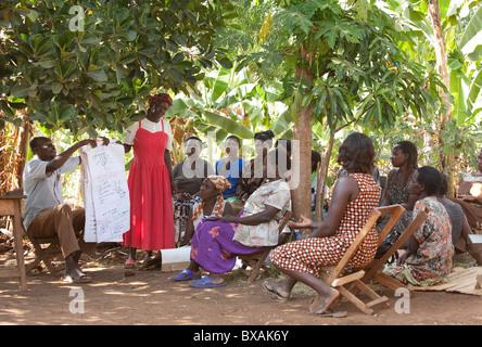 Villagers attend a community meeting in Buwanyanga Village - Sironko, Eastern Uganda, East Africa. - Stock Photo