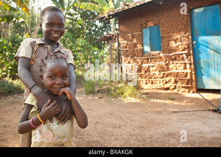 A brother and sister pose together in Buwanyanga Village - Sironko, Eastern Uganda, East Africa. - Stock Photo