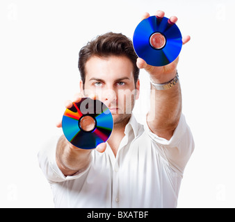 man in white shirt standing holding CD - isolated on white - Stock Photo