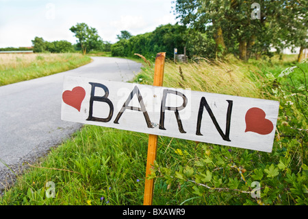 Sign with text barn next to country road - Stock Photo