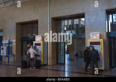 People buying tickets from machines at Stazione Centrale the main railway station Palermo Sicily Italy Europe - Stock Photo