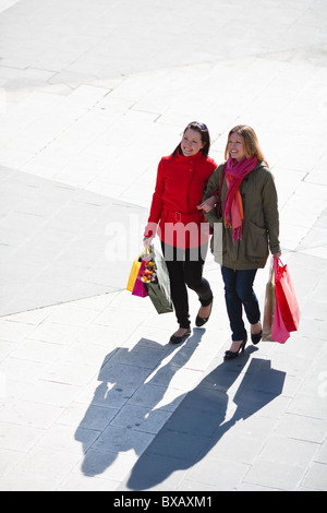 Pair of young women shopping - Stock Photo